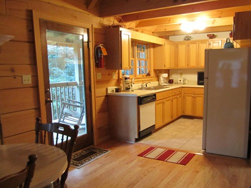 Cable TV, Hot tub, trash pick up, Two queen-size beds includes linens, bathroom shower/tub & two sinks, hairdryer, towels & wash clothes, kitchen includes range, refrigerator, microwave, toaster, coffeemaker | Highland Glade Cabin Rentals | Gatlinburg, TN